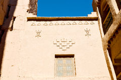 Blue window in morocco  old   and brown wall  construction Stock Photography
