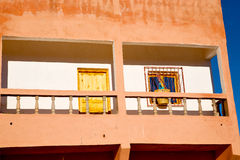 Blue window in morocco old construction brown Royalty Free Stock Images
