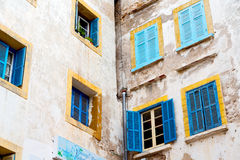 Blue window in  old    brown wall  construction Stock Image