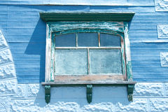 Blue Window. In old building stock photos
