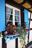 Blue window in old country cottage Royalty Free Stock Photography