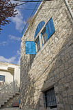 Blue window in old Jerusalem's house Stock Photography