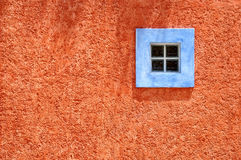 Blue window, orange wall - Tropical Royalty Free Stock Photography