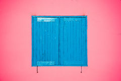 Blue window on pink wall Stock Image