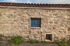 Blue window in a rustic wall in Sardinia Royalty Free Stock Photography