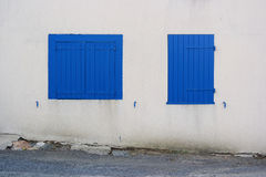 Blue window shutters Stock Photography