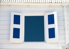 Blue Window and Shutters in White Wood Wall Stock Photos