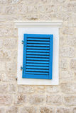 Blue window. On a stone house Stock Images