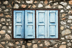 Blue window on stone wall Royalty Free Stock Images