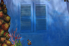 Blue window in the sunlight Royalty Free Stock Images