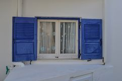 Blue window on typical house in Greece stock photography
