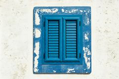 Blue window under a shiny sun stock images