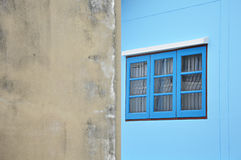 Blue window on the wall Royalty Free Stock Image