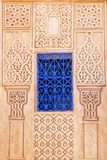 Blue window at a wall with Arabic ornaments. In Marrakesh, Morocco Royalty Free Stock Photography