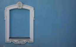 Blue window. White outline of the window on the blue wall Stock Photo