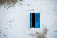 Blue Window on White Wall. Open blue window on white wall in Morocco with copyspace Royalty Free Stock Image
