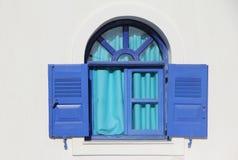 Blue window. On the white wall. Greece, Santorini Island Stock Photography