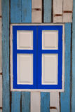 Blue window on wooden wall Royalty Free Stock Images