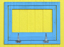 Blue Window on Yellow Wood Wall Royalty Free Stock Photo