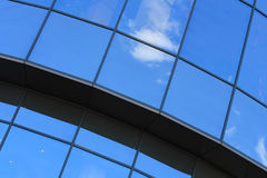 Blue windows. Blue sky reflected by semitransparent windows Stock Photography