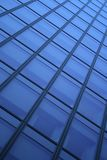 Blue windows background. Blue windows of a skyscraper, forming a diagonal pattern stock photography