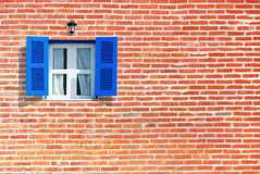 Blue windows on brick wall. Background Royalty Free Stock Images