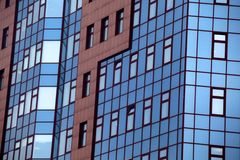 Blue windows building background day light. Blue windows reflection building background day light Stock Images