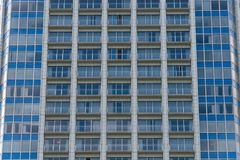 The blue windows of the building, background texture pattern of. The windows of the building, background texture pattern of the windows Stock Photo