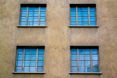 Blue Windows. Close-up of four building Windows Royalty Free Stock Photography