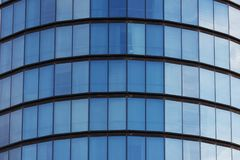 Blue windows of a cylindrical building. Blue windows of a cylindrical building background texture Royalty Free Stock Image