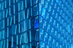 Blue windows. A detail of the windows of the Harpa Concert Hall in Reykjavik. This Icelandic opera house is a architectural beauty Stock Images