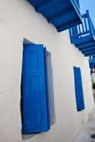 Blue windows in Mykonos, Greece Stock Photo