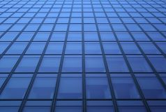 Blue windows pattern. Glass panels: blue windows of a skyscraper stock photography