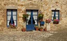 Blue windows and a stone wall Royalty Free Stock Image