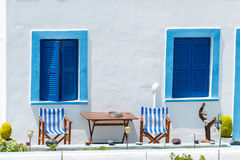Blue Windows on a White Building in Oia, Santorini Stock Images