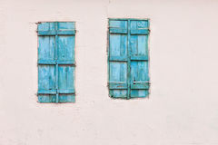 Blue windows and white wall Stock Photos