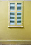 Blue windows on yellow wall. Royalty Free Stock Photography