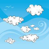 Blue Windy Sky With Swirly Clouds And Birds Stock Images
