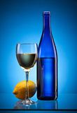 Blue wine bottle and lemon Stock Photo