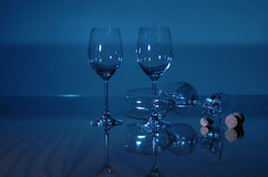 Blue Wine Glasses. Empty wine glasses sparkel in blue light Stock Photography