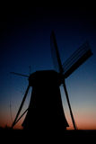 Blue wings of the dutch. Dutch wind mill early in the morning royalty free stock photography