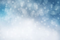Blue Winter Background. With bokeh and snowflakes Stock Photography