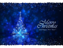 Blue winter background with Christmas tree Stock Photo