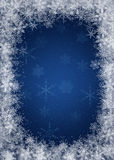 Blue Winter Background. Dark Blue Winter Background with snowflakes Royalty Free Stock Images