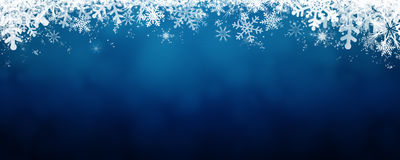 Blue winter background with snow and snowflackes. Long format Royalty Free Stock Image