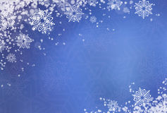 Blue winter background with snow Stock Images