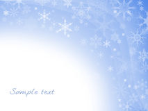 Blue winter background with snowflakes Royalty Free Stock Image