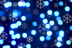 Blue Winter Background with Snowflakes. Various shades of blue with abstract lights and snowflakes Royalty Free Stock Images