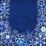 Blue winter background with snowflakes. Beautiful blue winter background with white ornate snowflakes. New Year and Christmas festive card with place for text Royalty Free Stock Photos