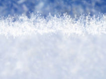 Blue winter background with snowflakes Royalty Free Stock Photography